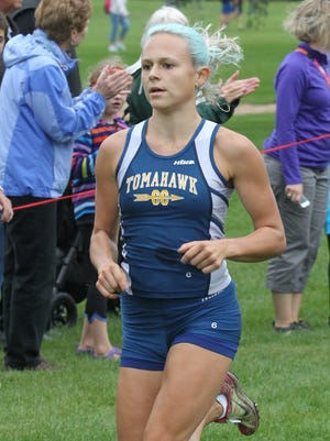 Tomahawk's Dani Whiting cruised to victory in the D2/3 girls varsity race at the Smiley Invitational on Saturday.