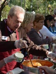 Naples Mayor Bill Barnett dishes up hearty soup during the Harry Chapin Food Bank Empty Bowls event.