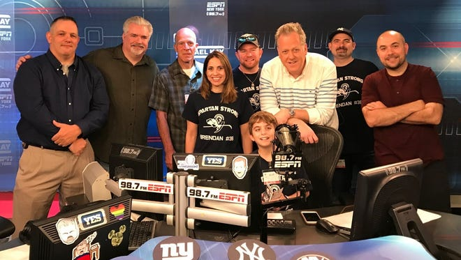 "Brendan O'Callaghan of Paramus, at the microphone, visits ""The Michael Kay Show"" June 11, 2018"