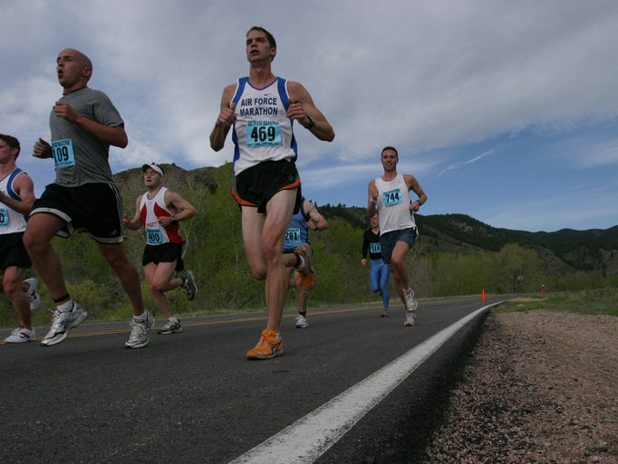 Runners exit the Poudre Canyon during the Colorado Marathon which began at Steven's Gultch running down through the Poudre River Canyon and ending at Linden and Walnut in the Old Town Plaza on Sunday May 7, 2006. (Photo by jamie Haverkamp/ For the Coloradoan)