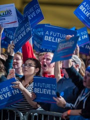 Supporters of Democratic presidential candidate Sen. Bernie Sanders, I-Vt., cheer as he speaks in Essex Junction on Tuesday, March 1, 2016.