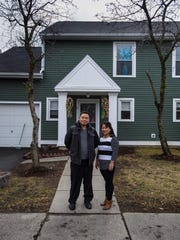 Lal, left, and Man Gurung stand outside their home in Burlington on Friday, April 8, 2016, that they bought through Champlain Housing Trust's Shared Equity Program.