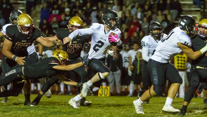 Pine View quarterback Dallin Brown (2) carries the ball during the game against Cedar, Oct. 11, 2017, in Cedar City.