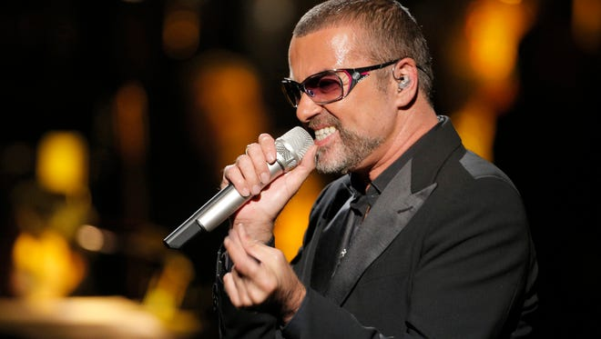 """In this Sept. 9, 2012 file photo, British singer George Michael sings in concert to raise money for AIDS charity Sidaction, in Paris, France. A British coroner said Tuesday, March 7, 2017, that George Michael died of natural causes as the result of heart disease and a fatty liver. Darren Salter, senior coroner for Oxfordshire, says a post-mortem has found that the singer died of """"dilated cardiomyopathy with myocarditis and fatty liver."""" Michael died at his home in southern England, on Dec. 25, 2016."""