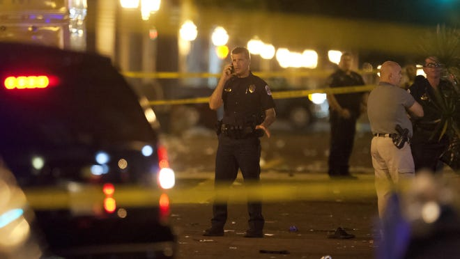 Fort Myers Police Lt. Jay Rodriguez works the scene of a fatal shooting Saturday during ZombiCon in downtown Fort Myers. A man was killed and five others wounded Saturday in the shooting.
