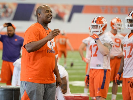 Clemson defensive line coach Todd Bates coaches during the Tigers' opening spring practice on Wednesday.
