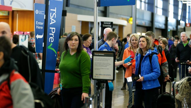 Travelers wait in the PreCheck expedited security line at Seattle-Tacoma International Airport on March 17, 2016.