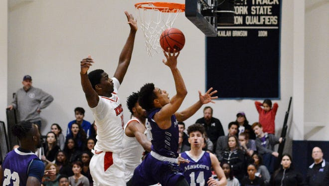 Masters' Isiah Thompson splits two defenders in the second quarter of the NYSAIS championship game on Monday at School of the Holy Child.