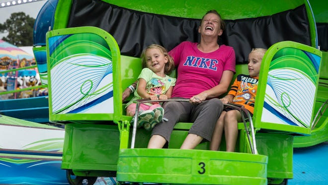 Fairgoers enjoy a ride at the 2016 Delaware County Fair.