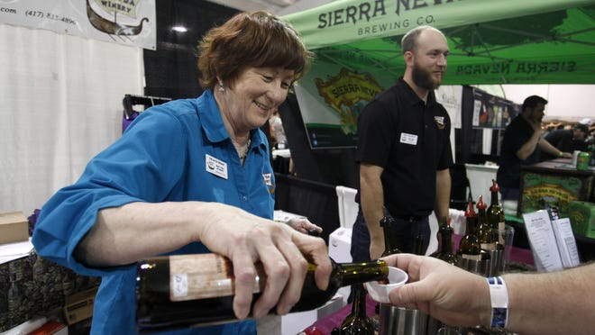 Fran Overboe, part owner of Springfield's OOVVDA Winery, pours a sample of wine during the Beer, Wine, Cheese and Chocolate Festival in 2015.
