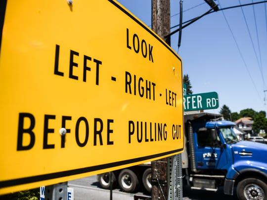 A sign at the intersection at North Seventh Street and Kimmerlings and Kochender roads warns drivers to 'Look left, right, left before pulling out' on Tuesday, July 19, 2016.