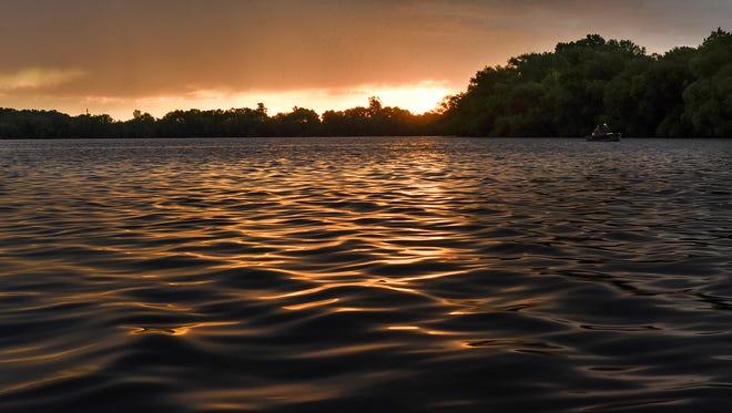 """The sun rises for the summer solstice, also known as the longest day of the year Tuesday, June 20, on North Diamond Lake in Rogers. The term """"solstice"""" derives from the Latin word """"solstitium,"""" meaning """"sun standing still."""""""