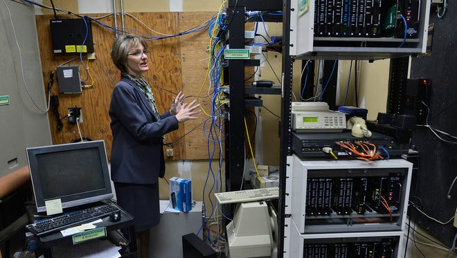 Bonnie Rodness, general manager of the Holiday Inn Hotel & Suites, shows some of the switches and routers in the hotel's server room April 21 in St. Cloud. The hotel recently upgraded its Wi-Fi for guests.