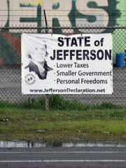 A sign on a fence in Oroville urges residents to support secession and the creation of a new state, the State of Jefferson. Due to northern California's low population, the area has only six state-level representatives, compared to 114 for the southern half of the state, which is home to populous cities like Los Angeles.