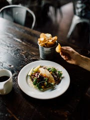 Cauliflower Tacos, topped with a red pepper crema and salsa, appear on Archive Coffee & Bar's menu.