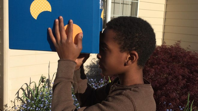 While Aug. 21's eclipse is something to see, it is not safe to look at the sun unaided. Instead, make your own eclipse viewer. To use your viewer, stand outside with your back toward the sun. Look in the bottom hole in your box lid, and position your box so that the sunlight is coming through the foil hole and is centered on the white paper inside. During the eclipse, you will be able to see a dark circle (the moon) move to cover the bright light circle.