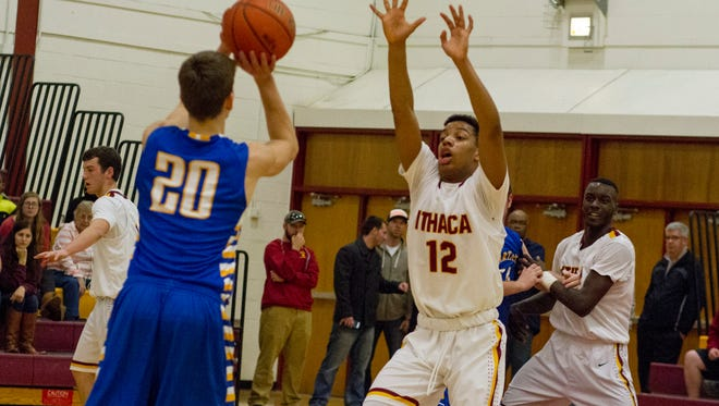 Ithaca sophomore swingman Jordanny Cuevas-Muerte defends a shot by Maine-Endwell's Joe Shindyakov in their STAC matchup at Ithaca on Wednesday. IHS won, 84-65.