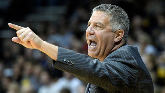 Auburn head coach Bruce Pearl yells to his team during an NCAA college basketball game against Colorado, Monday, Nov. 17, 2014, at the Coors Event Center in Boulder, Colo. Colorado won 90-59.