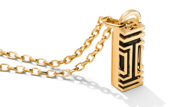 The Tory Burch for Fitbit Fret Pendant Necklace, made of solid brass, is based on the decorative, open fretwork that's a signature of Tory Burch design. It's on a thin link chain and costs $175.
