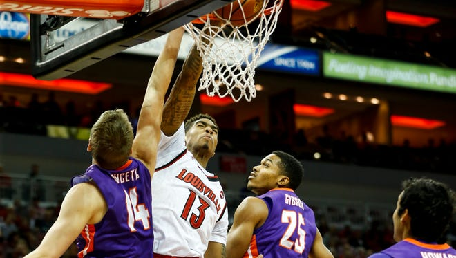 Louisville's Ray Spalding goes up for the slam dunk against Evansville's Sergej Vucetic (#14) and Duane Gibson. Nov. 11, 2016