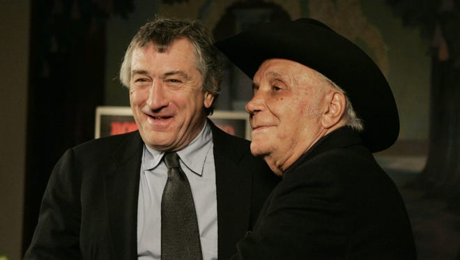 """FILE - In this Jan. 27, 2005, file photo, Robert DeNiro, left, and boxer Jake LaMotta stand for photographers before watching a 25th anniversary screening of the movie """"Raging Bull"""" in New York. LaMotta, whose life was depicted in the film """"Raging Bull,"""" died Tuesday, Sept. 19, 2017, at a Miami-area hospital from complications of pneumonia. He was 95."""