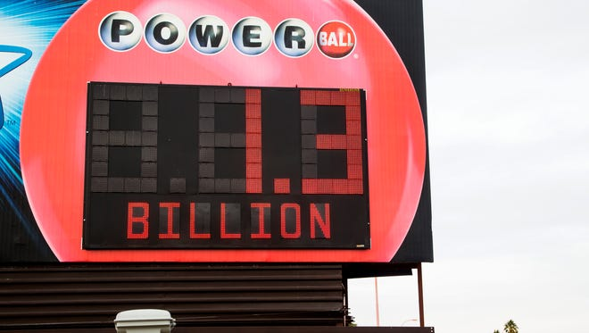 A sign for the Powerball displays the $1.3 Billion dollar prize above a Chevron station on Jan. 10, 2016 in Phoenix, Ariz.