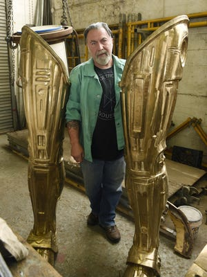 """Giorgio Gikas, who has restored some of the historical statues around the city, says RoboCop is a """"cultural symbol"""" of an era in Detroit."""