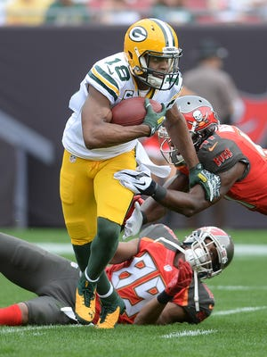 Green Bay Packers receiver Randall Cobb (18) breaks a tackle against the Tampa Bay Buccaneers from Raymond James Stadium.