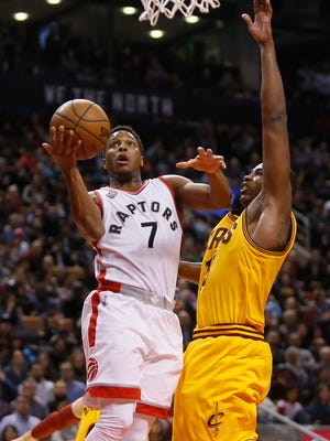 Toronto Raptors guard Kyle Lowry (7) shoots the ball as Cleveland Cavaliers center Tristan Thompson (13) defends at the Air Canada Centre. The Raptors won 99-97.