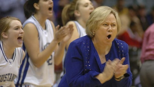 Smoky Mountain coach Cindi Simmons cheers for her team as they take control of the game against Salisbury during the Western Regional Basketball Tournament in Winston-Salem.  March 2, 2007.