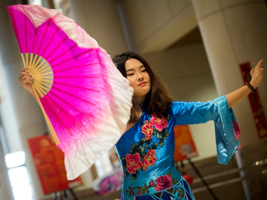 A Chinese fan dance is performed at UT's Confucius