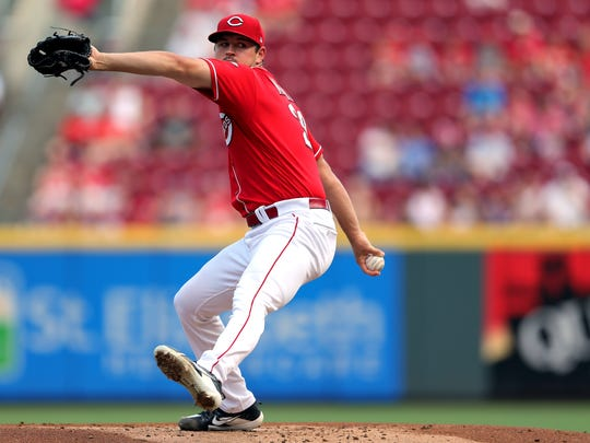 Cincinnati Reds starting pitcher Tyler Mahle (30) delivers