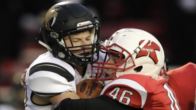 Franklin's Tanner Dykstra collides with Kimberly linebacker Kyle Mayfield during the state title game Friday.