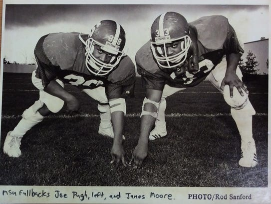 Michigan State fullbacks, Joe Pugh (from left) and