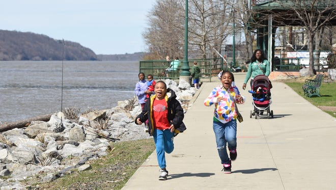 Sariyah Thompson, right, 6, and her cousin Ishmel Hunt, left, 7, of the City of Poughkeepsie run down to Victor C. Waryas Park in the City of Poughkeepsie.