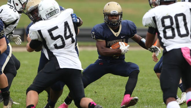 Freehold's Ashante Worthy, shown in a game from last season, accounted for 10 TDs, - eight rushing and two passing - in Freehold's wild 69-56 win at Pennsauken Saturday in a NJSIAA Central Group IV quarterfinal-round game.