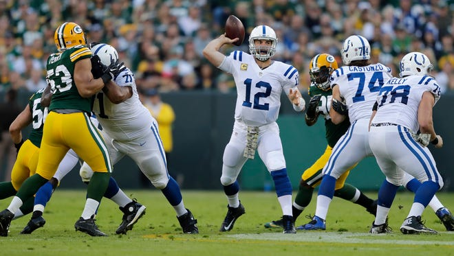 Indianapolis Colts' Andrew Luck throws as the Green Bay Packers host the Indianapolis Colts on Sunday, November 6, 2016, at Lambeau Field in Green Bay, Wis.
