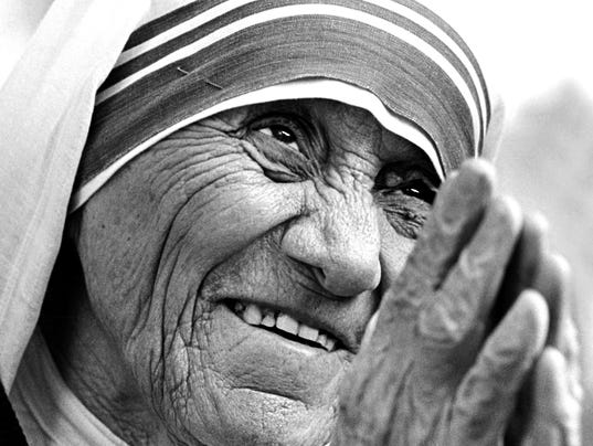 29_Mother Teresa would often clasp her hands together taking a bow.  Gandhi was known for this gesture.  The gesture is traditional in many Eastern cultures and substitutes for a hand shake, but has additional meanings of peace attached to it.
