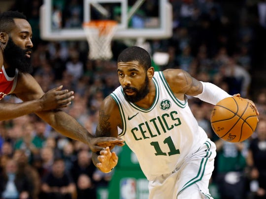 Boston Celtics guard Kyrie Irving (11) is guarded by