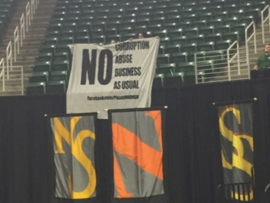 A banner created by a group called Pissed Off MSU was
