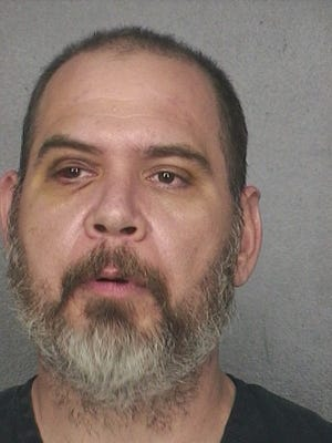 Benjamin Siegel, owner of a Florida reptile shop, was arrested Friday after allegedly hitting employees with a bearded dragon lizard.