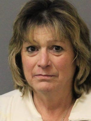 Mary Coletti, 56, of Cortlandt Manor, was arrested after she sideswiped a telephone pole on Red Mill Road in Cortlandt while driving 35 students to Walter Panas High School at 7 a.m. on Monday, May 11, 2015.