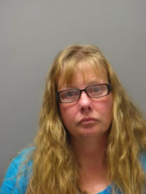 Jennifer Brumbley, 44, is facing charges related to a purse snatching.