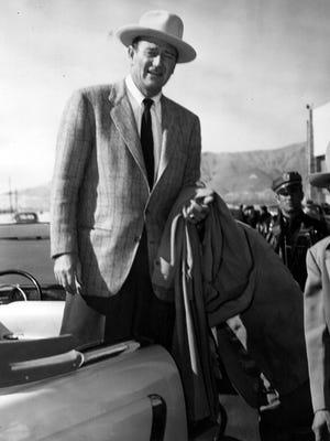 John Wayne arrives at El Paso International Airport in November 1953.