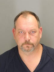 Michael Sumner charged as aiding wife in theft of city funds.
