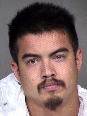 Evan Sharp, 23, stabbed a woman at a counseling meeting in Mesa on Saturday, Oct. 3, 2015, according to police.
