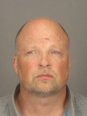 Benjamin J. Smith, 46, of Penfield, was charged with arson and other crimes for a wild Saturday evening in Pittsford.