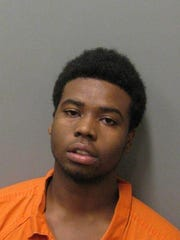 Tarick Moore is charged with capital murder during a robbery