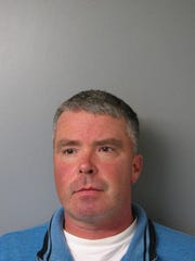 Shawn P. Moore, 40, of Lewes has been charged with