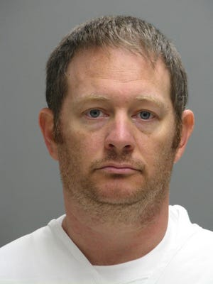 Federal authorities say Secret Service agent Lee Robert Moore, shown in a booking photo, sent obscene images and texts to someone he thought was a 14-year-old Delaware girl, sometimes doing it while on duty at the White House.